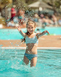 Little girl  in the pool Royalty Free Stock Photos
