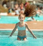 Little girl  in the pool Stock Photos