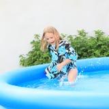 Little girl in pool Stock Photo