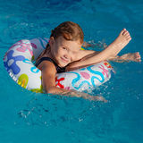 Little girl in the pool  with rubber ring Royalty Free Stock Photo