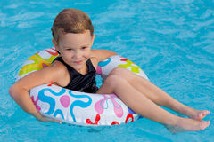 Little girl in the pool  with rubber ring Royalty Free Stock Photos