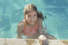 Little Girl At Pool's Edge Stock Photos
