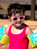 Little girl in a pool Stock Images