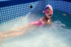 Little girl in the pool, summer Stock Photography