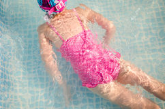 Little girl in the pool, summer Stock Images