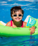 Little girl in a pool Stock Photo
