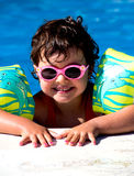 Little girl in a pool Royalty Free Stock Image