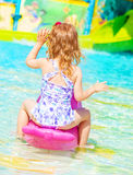 Little girl in poolside Stock Images
