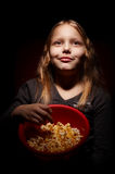 Little girl with popcorn Stock Image