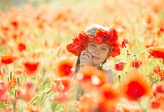 Little girl in a poppies royalty free stock photography