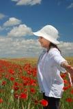 Little girl on poppy field Stock Photo