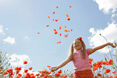 Little girl in poppy field Stock Photography