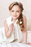 Little girl portrait. Cute beautiful little girl holding white flower Royalty Free Stock Photos