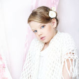 Little girl portrait. Beautiful little girl with perfect makeup and hair-dress with flowers lookung at you Stock Photo