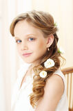 Little girl portrait. Beautiful little girl with perfect makeup and hair-dress with flowers lookung at you Stock Image
