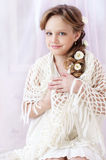 Little girl portrait. Beautiful little girl with perfect makeup and hair-dress with flowers looking at you Stock Image