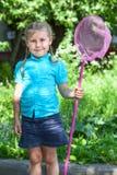 Little girl portrait with butterfly net Stock Image