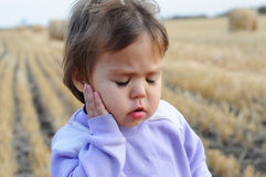 Little girl portrait complaining an ache Royalty Free Stock Photography
