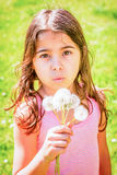 Little girl portrait with dandelion in her hand. Beautiful Little girl portrait with dandelion in her hand Royalty Free Stock Photography