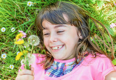 Little girl portrait with dandelion in her hand. Beautiful Little girl portrait with dandelion in her hand Royalty Free Stock Photos