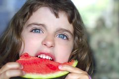 Little girl portrait eating watermelon slice Royalty Free Stock Photo