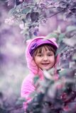 Little Girl Portrait In A Lilac Garden Stock Images