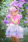 Little girl portrait in a lilac garden Royalty Free Stock Photography
