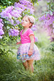 Little girl portrait in a lilac garden Royalty Free Stock Image