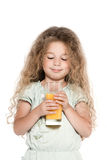 Little girl portrait orange juice drink Royalty Free Stock Images