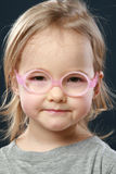 Little girl portrait in pink glasses Stock Photography