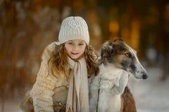 Little girl portrait with russian borzoi dog