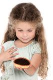 Little girl portrait showing chocolate pie Royalty Free Stock Images