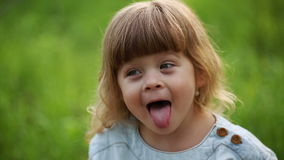 Little girl poses funny faces stock footage