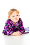A little girl poses, lies Stock Photos