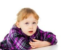 A little girl poses, lies Royalty Free Stock Photos