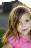 Little girl posing. A little girl posing in the front yard Royalty Free Stock Photo
