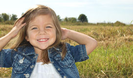 Little girl posing. A little girl posing in the front yard Stock Photography