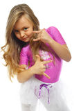 Little girl posing. Little girls posing after training isolated on white Royalty Free Stock Photos