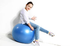 Little girl posing. With a rubber ball Stock Images