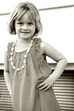 Little Girl Posing. Little girl all dressed up and posing Royalty Free Stock Photo