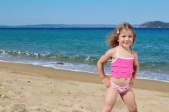 Little girl posing on the beach Stock Images