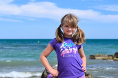 Little girl posing on the beach Stock Photography
