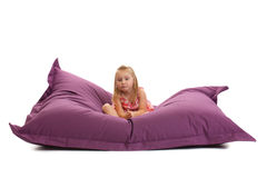 Little girl posing on beanbag Stock Photo