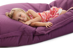 Little girl posing on beanbag Stock Photography