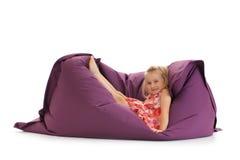 Little girl posing on beanbag royalty free stock photo