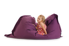 Little girl posing on beanbag Stock Image