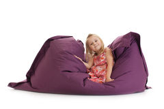Little girl posing on beanbag Stock Photos