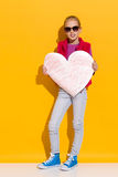 Little girl posing with big paper heart Royalty Free Stock Image