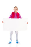 Little girl posing with blank banner. Royalty Free Stock Photography
