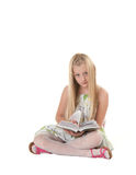 Little girl posing with book Royalty Free Stock Photos